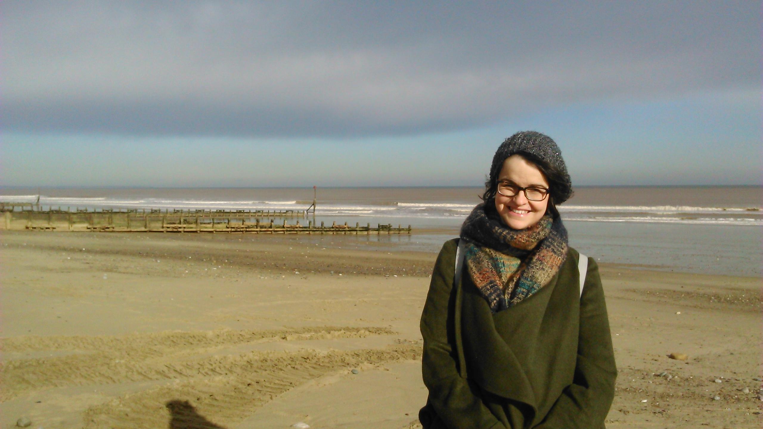 Alex Medcalf on a beach