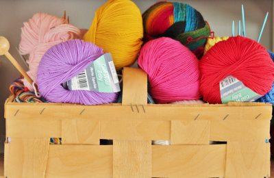 Box of wool and knitting needles